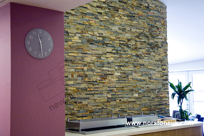 Reception area with Norstone Ochre cladding  feature wall